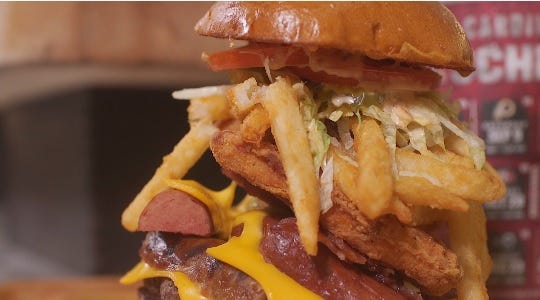 Find the $22 Gridzilla Burger behind Section 102.