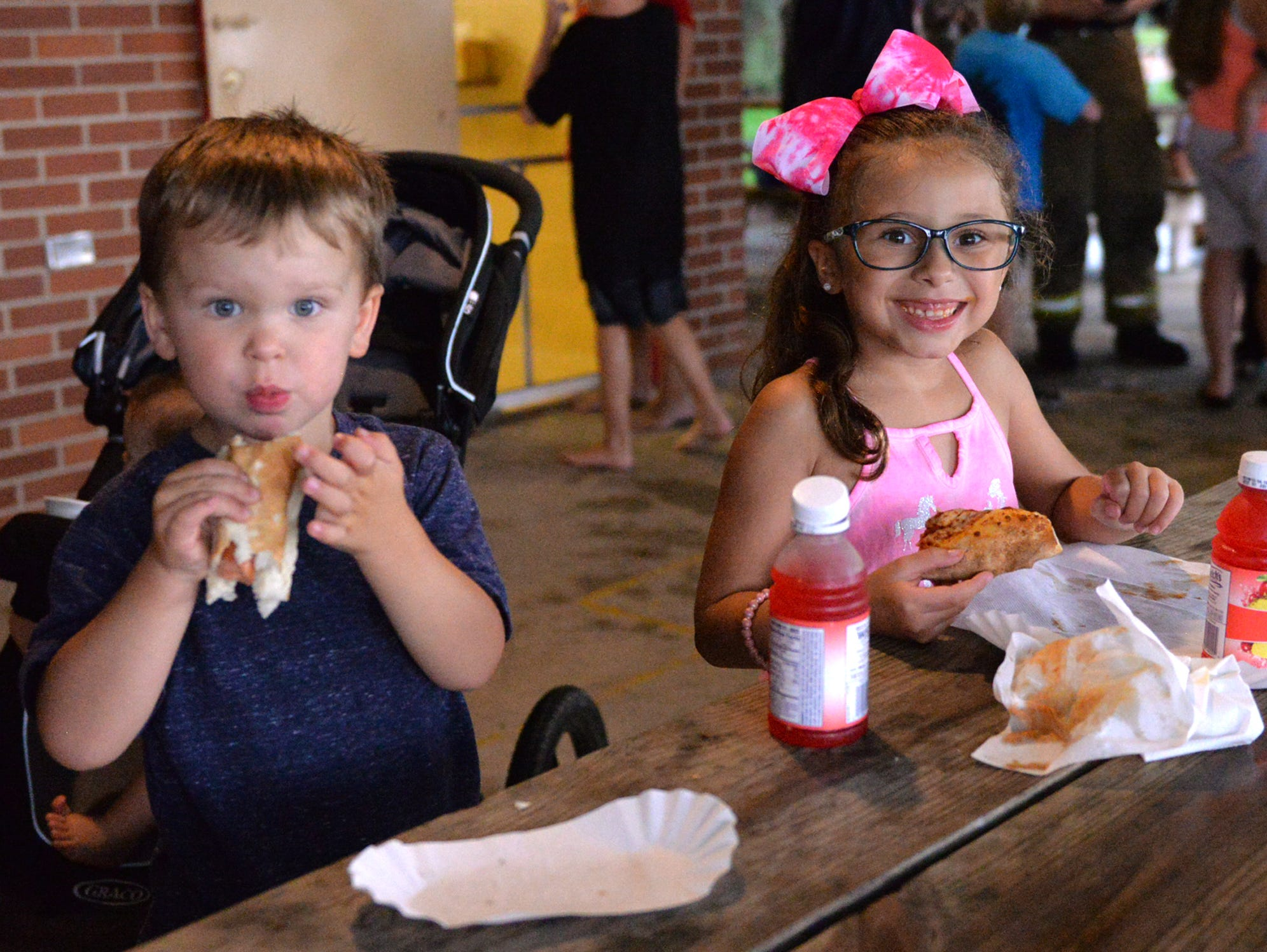 From left, two-year old Wyatt Yoder and Layna Mejias, 2, enjoy dinner at Cleona Borough Park during Cleona Borough Police Department's National Night Out held on Tuesday evening, August 7, 2018.