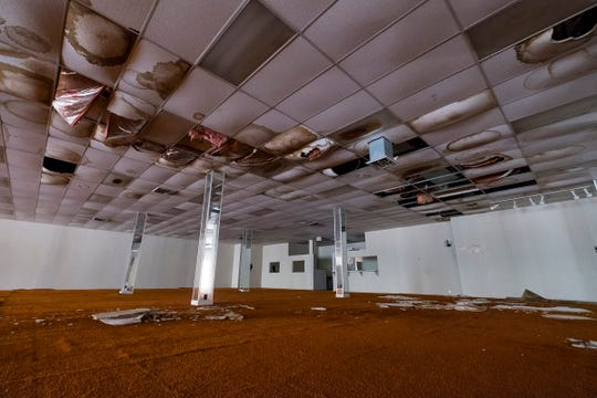 Wet ceiling tiles have crumbled to the floor on the first floor of the Woolworth's building in Port Huron.