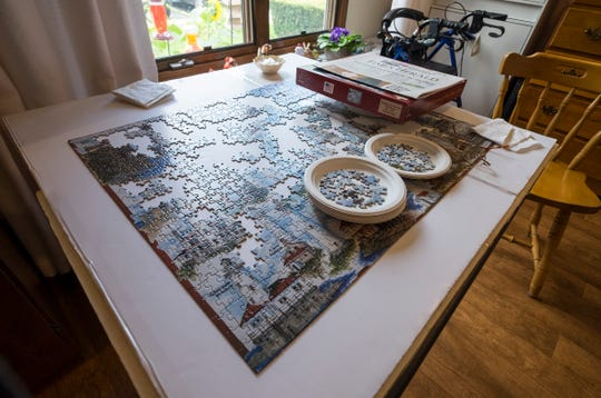 A puzzle nearing completion sits on the table in Sally Eagen's room at Lakeshore Woods.