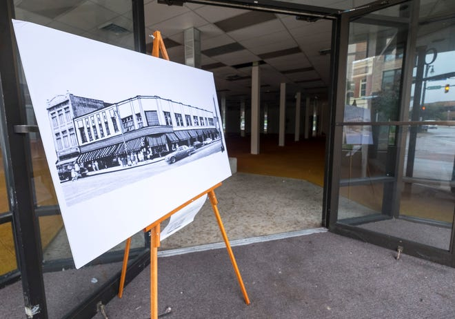 A rendering of the redeveloped plans for the Woolworth building sit on an easel inside the building's front doors.