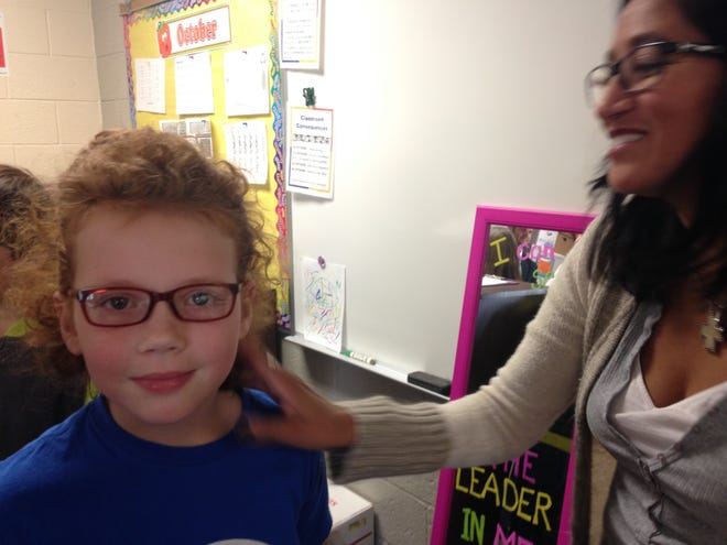 Melissa Howard is pleased with her new pair of prescription eyeglasses. The St. Clair County Health Department is offering free vision and hearing screenings for kindergartners and pre-schoolers.