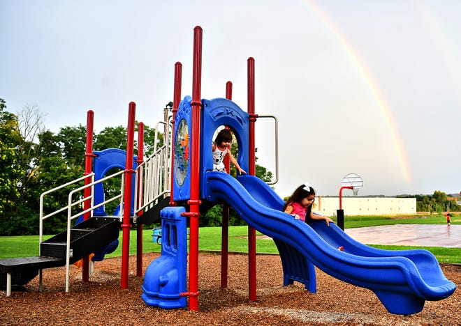 A rainbow rests overhead while children play at Lloyd Kauffman Playground during National Night Out at North York Borough Park in North York Borough, Tuesday, Aug. 7, 2018. Dawn J. Sagert