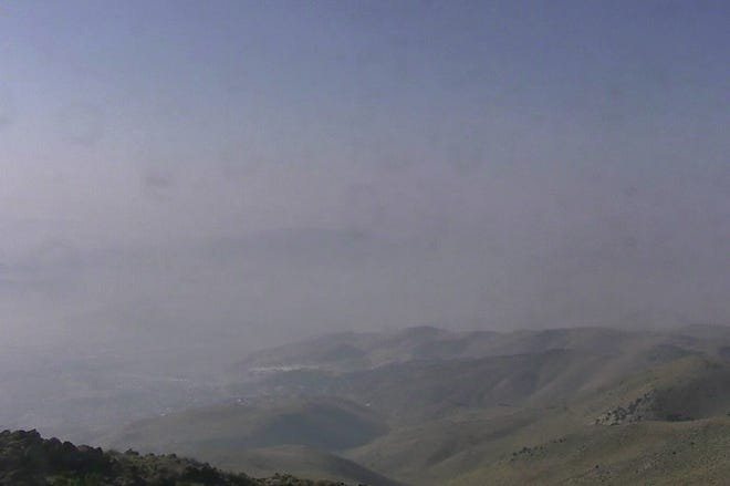 Heavy smoke hangs over the Gardnerville area Wednesday, Aug. 8, 2018 in this image from AlertTahoe's webcam, looking south from McClellan Peak.