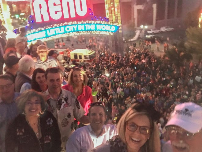 Reno Mayor Hillary Schieve poses for a selfie with the crowd at the relighting of the downtown Reno Arch.