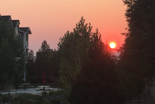 Sunrise was blood-red in central Reno as air quality continued to suffer from wind-borne smoke generated by Northern California wildfires on Wednesday, Aug. 8, 2018.