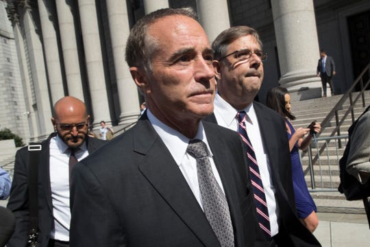 Republican U.S. Rep. Christopher Collins, center, leaves federal court, Wednesday, Aug. 8, 2018, in New York.