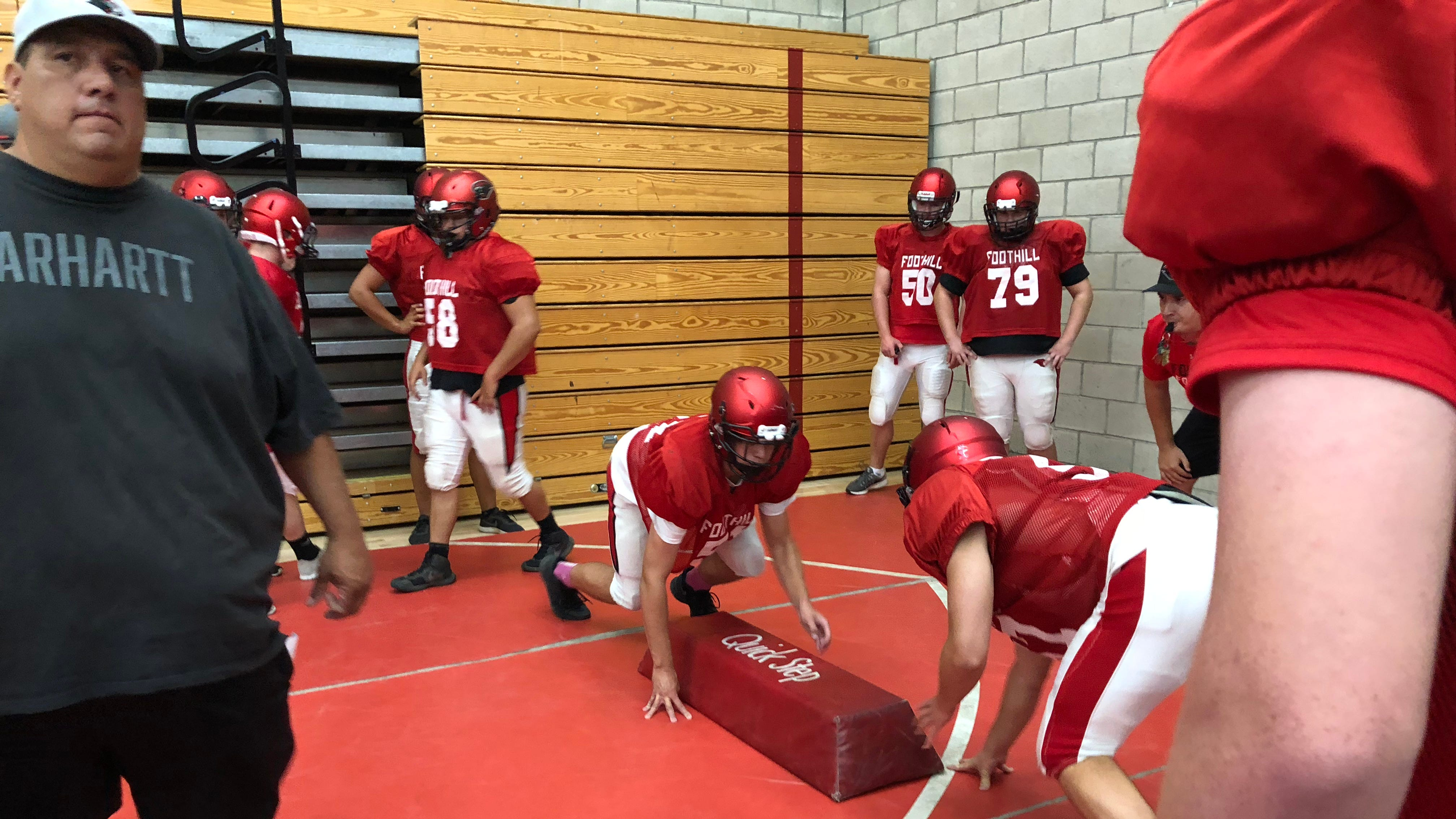 Varsity football players at Foothill High School participate in hitting drills at the start of practice on Tuesday, Aug. 7. Poor air quality due to the Carr Fire has pushed all athletics indoors in affected areas, according to Shasta and Anderson district superintendents.