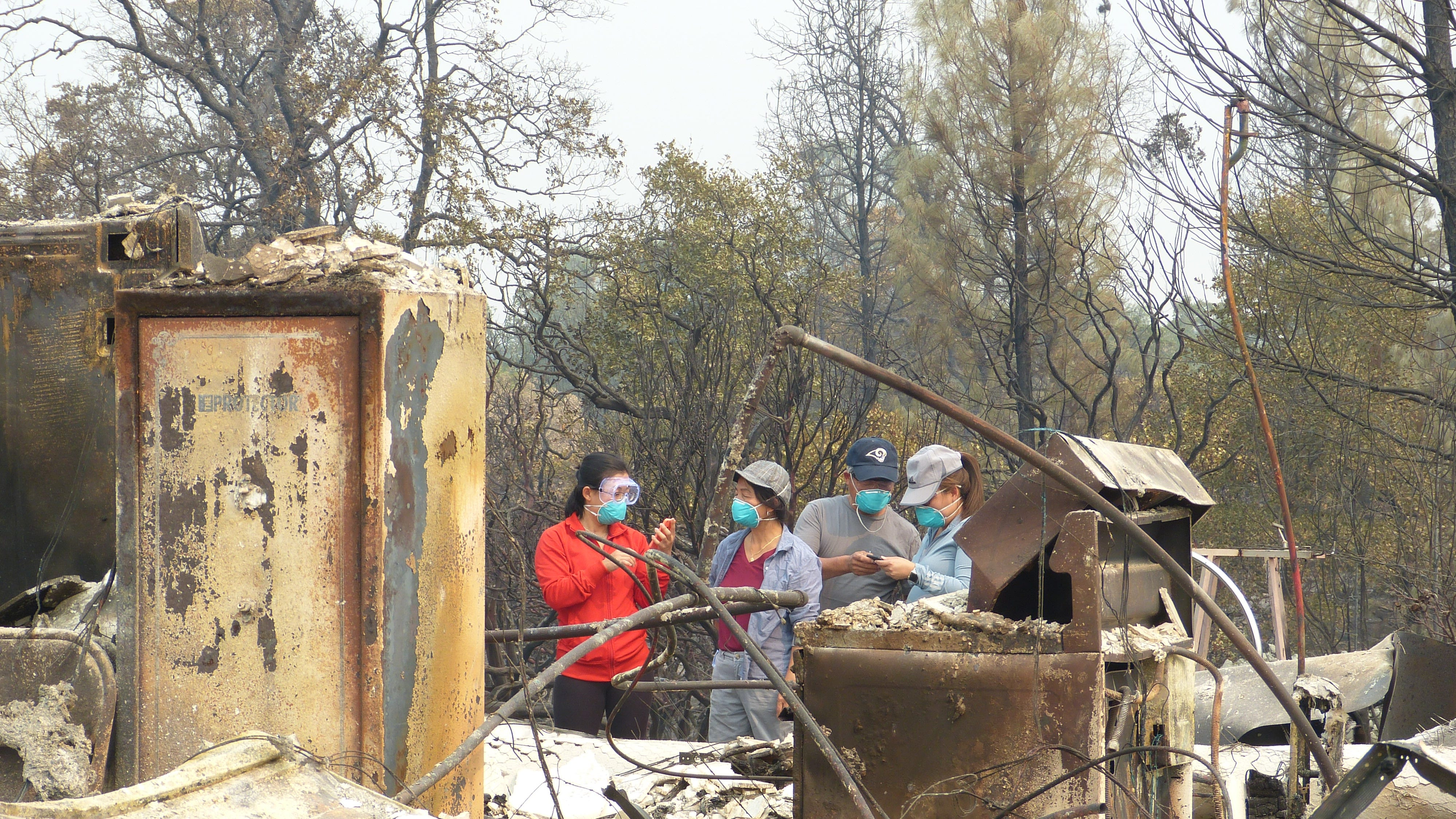 The Saechao family arrived at their home to assess the damage with an insurance agent.