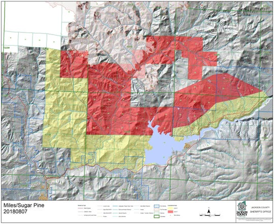 Areas in red are under Level 3 'Go now' evacuation orders while  areas in yellow are under Level 2 'Be set' orders due to the Miles Fire.