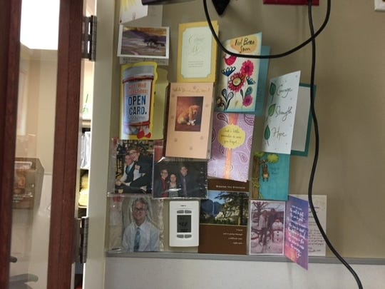 A wall in Zachary Sutterfield's room showing photos and letters on Aug. 7, 2018 at San Antonio Military Medical Center.