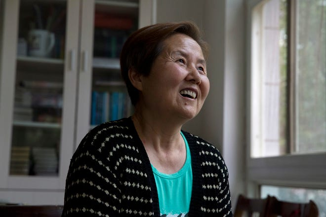 In this photo taken Sunday, June 3, 2018, Xu Shijuan, a 63-year-old Seventh-Day Adventist talks about her faith at her home in Zhengzhou in central China's Henan province. Under President Xi Jinping, China's most powerful leader since Mao Zedong, believers are seeing their freedoms shrink dramatically even as the country undergoes a religious revival. For four years, Xu used her living room for house church gatherings. She stopped in March after a group of men led by a local official ordered her to disband the meeting of about two dozen elderly Christians. (AP Photo/Ng Han Guan)