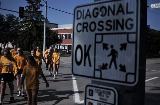 "The Augustana volleyball team crosses at 33rd Street and Grange Avenue Wednesday, Aug. 8, 2018 to inaugurate the new ""pedestrian scramble."""