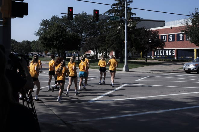 The Augustana volleyball team runs across the new pedestrian scramble Wednesday, Aug. 8, 2018 at the intersection of 33rd Street and Grange Avenue in Sioux Falls, SD.