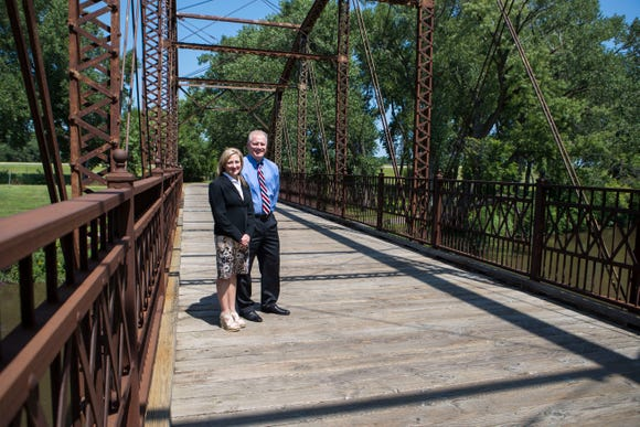 Kameron Carlson and Nancy Carlson pose on the Yankton Trail Bridge in Sioux Falls. Their efforts led to a historical marker being added to the site.