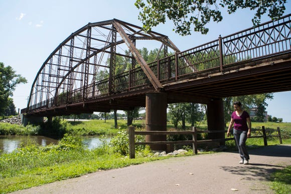 Andrea Nelson walks by Yankton Trail Bridge in Sioux Falls, S.D. Wednesday, Aug. 8, 2018.