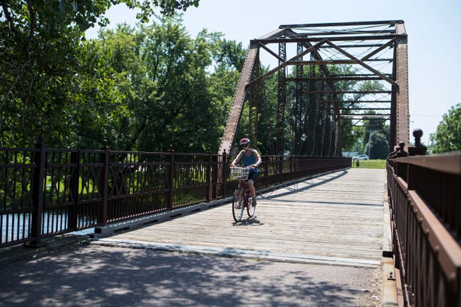 A cyclist rides across the Yankton Trail Bridge in Sioux Falls, located near 57th Street and Western Avenue.