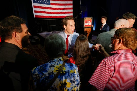 Josh Hawley greets supporters after speaking during the GOP watch party at the University Plaza Convention Center on Tuesday, Aug. 7, 2018.