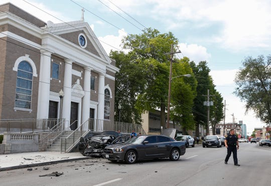 Springfield police investigate the scene of an incident on Jefferson Avenue and Cherry Street where a vehicle crashed into the outside of St. Agnus Cathedral during a pursuit. Three suspects were transported to the hospital.