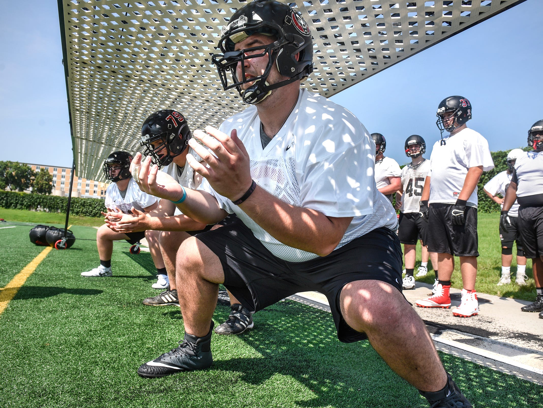 Linemen complete a drill during St. Cloud State University football practice Wednesday, Aug. 8, at Husky Stadium in St. Cloud.