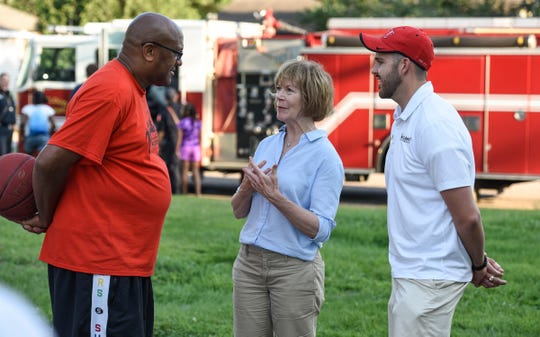 U.S. Sen. Tina Smith talks with people during National Night Out activities at Promise Neighborhood of Central Minnesota Tuesday, Aug. 7, in St. Cloud.
