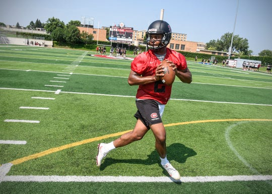 St. Cloud State University quarterback Dwayne Lawhorn runs a footwork drill during practice Wednesday, Aug. 8, at Husky Stadium in St. Cloud.