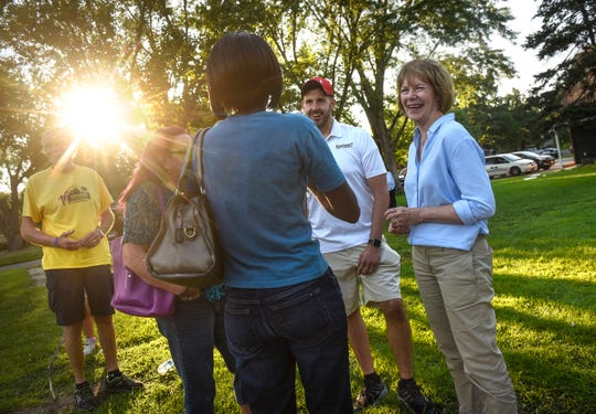 U.S. Sen. Tina Smith talks with people  during National Night Out activities at Promise Neighborhood of Central Minnesota Tuesday, Aug. 7, in St. Cloud. Smith is running in Tuesday's primary to be the Democrat on the Nov. 6 ballot for the Senate seat to which she was appointed to replace Al Franken.