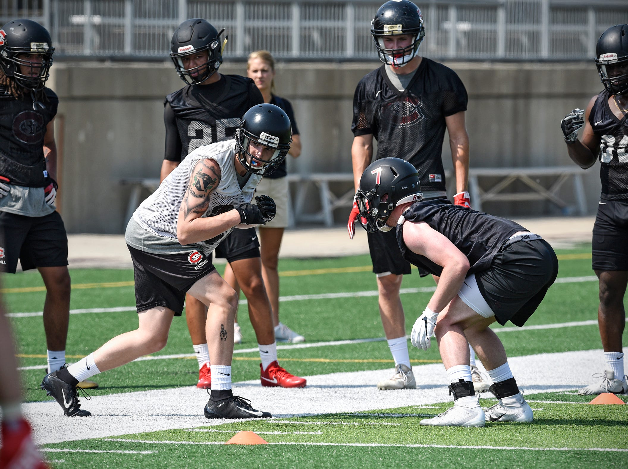 Players run through a drill during practice Wednesday, Aug. 8, at Husky Stadium in St. Cloud.