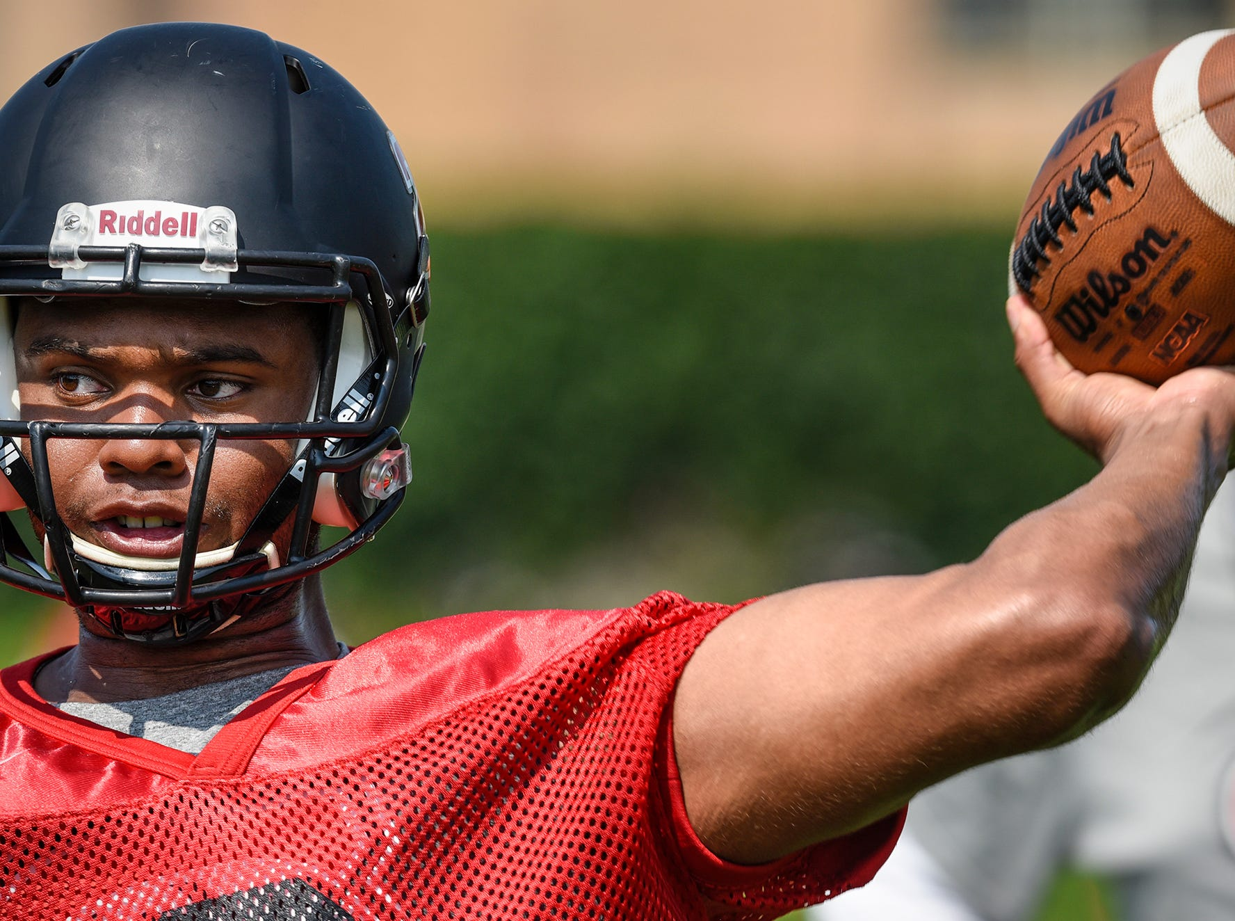 St. Cloud State University quarterback Dwayne Lawhorn throws a pass during practice Wednesday, Aug. 8, at Husky Stadium in St. Cloud.