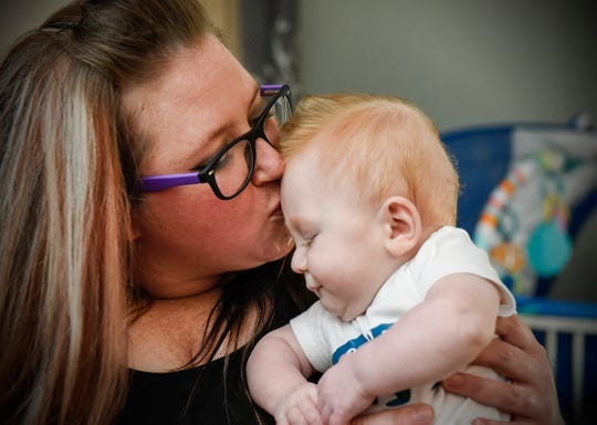 Winston Rochat cuddles with his mom, Jenny Borgstrom, Monday, Aug. 6, at their home in Little Falls. Rochat was born three months early at 1 pound, 1 ounce. He is now more than 13 pounds.