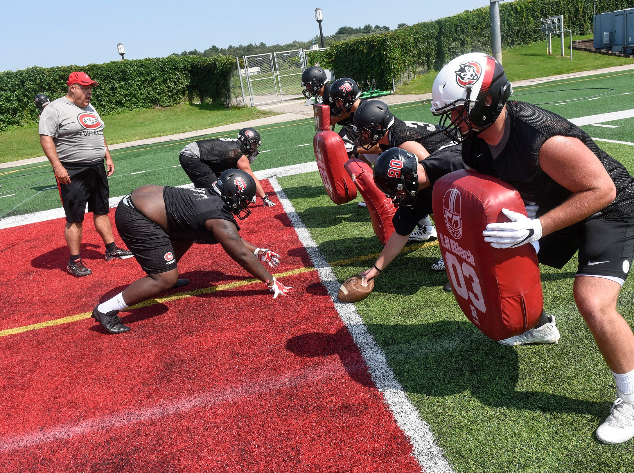 Players line up for a drill during practice Wednesday, Aug. 8, at Husky Stadium in St. Cloud.