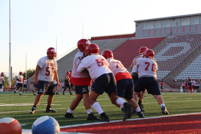 Dixie State football players perform in drills during the first practice of fall camp on Aug. 6, 2018.