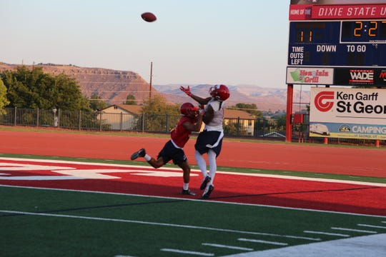 Dixie State wide receiver Kasey Allison jumps to make a catch during the first practice of fall camp