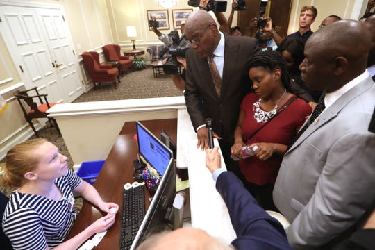"Rev. R.B. Holmes and Attorney Ben Crump join Britany Jacobs at the governor's office in the Capitol to ask secretary Rachel Walker for a meeting with an official to discuss the ""Stand your Ground"" law Wednesday, Aug. 8, 2018. The group was denied a meeting. Jacobs' partner, Markeis McGlockton, was shot dead by Michael Drejka during a dispute over a handicapped-accessible parking space in Clearwater. The Pinellas County Sheriff's Office declined to arrest Drejka, citing Florida's ""Stand Your Ground"" law."