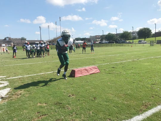 FAMU wide receivers practice their hip movement and footwork after the catch.