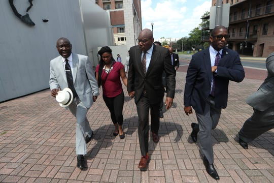 """Ben Crump, from left, Rev. R.B. Holmes and Andrew Gillum, join Britany Jacobs as they march to the Capitol during a rally against the """"Stand your Ground"""" law Wednesday, Aug. 8, 2018. Jacobs' partner, Markeis McGlockton, was shot dead by Michael Drejka during a dispute over a handicapped-accessible parking space in Clearwater. The Pinellas County Sheriff's Office declined to arrest Drejka, citing Florida's """"Stand Your Ground"""" law."""