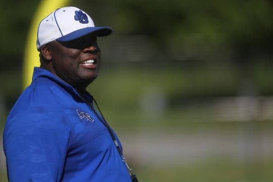 Godby football coach Corey Fuller watches as Godby's football team practices on the new turf at Gene Cox Stadium on Tuesday, Aug. 7, 2018.