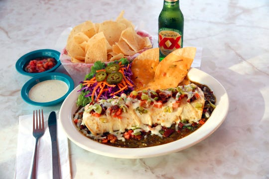 King Carne Burrito, stuffed with ground sirloin, bacon, green chiles and French fried potatoes is one of the specials at Chuy's.
