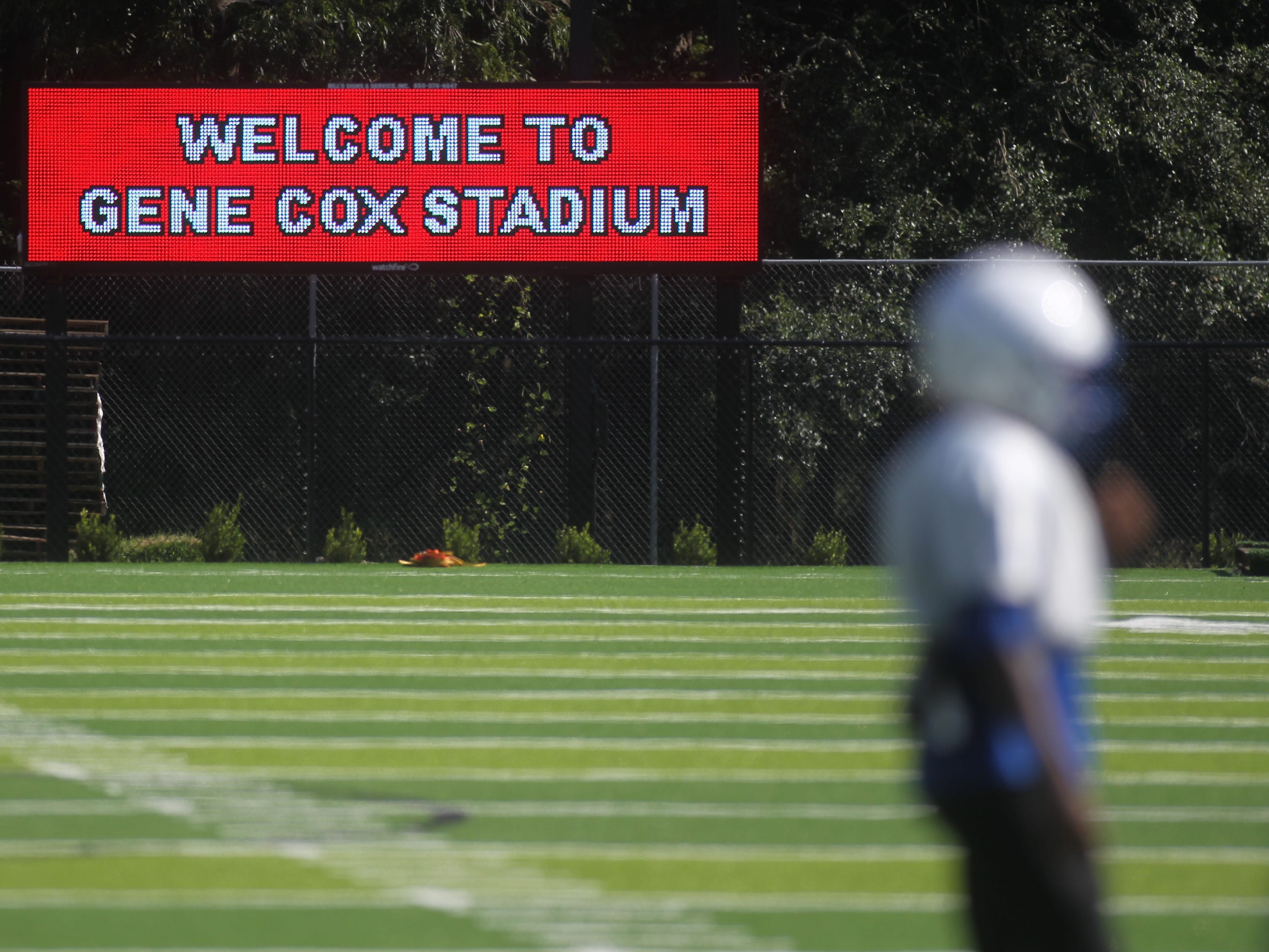 Godby's football team practices on the new turf at Gene Cox Stadium on Tuesday, Aug. 7, 2018.