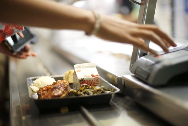 Leon High School students get a hot meal of baked BBQ rubbed chicken with mashed potatoes and greens during lunch.