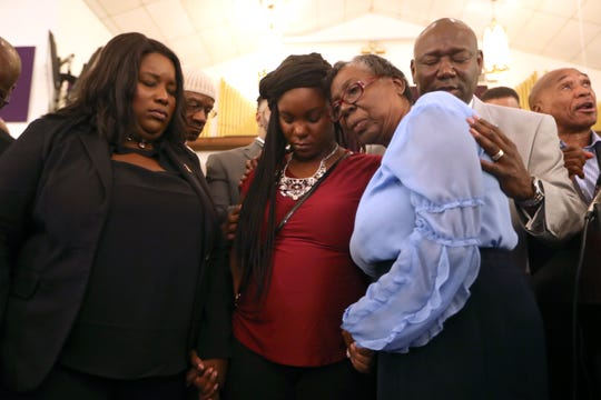 """Britany Jacobs, center, is surrounded by her lawyers Michele Rayner, left, Ben Crump, and Crump's mother Helen as they gather at Bethel Baptist Church for a rally against the """"Stand your Ground"""" law on Wednesday, Aug. 8, 2018. Jacobs' partner, Markeis McGlockton, was shot dead by Michael Drejka during a dispute over a handicapped-accessible parking space in Clearwater. The Pinellas County Sheriff's Office declined to arrest Drejka, citing Florida's """"Stand Your Ground"""" law."""