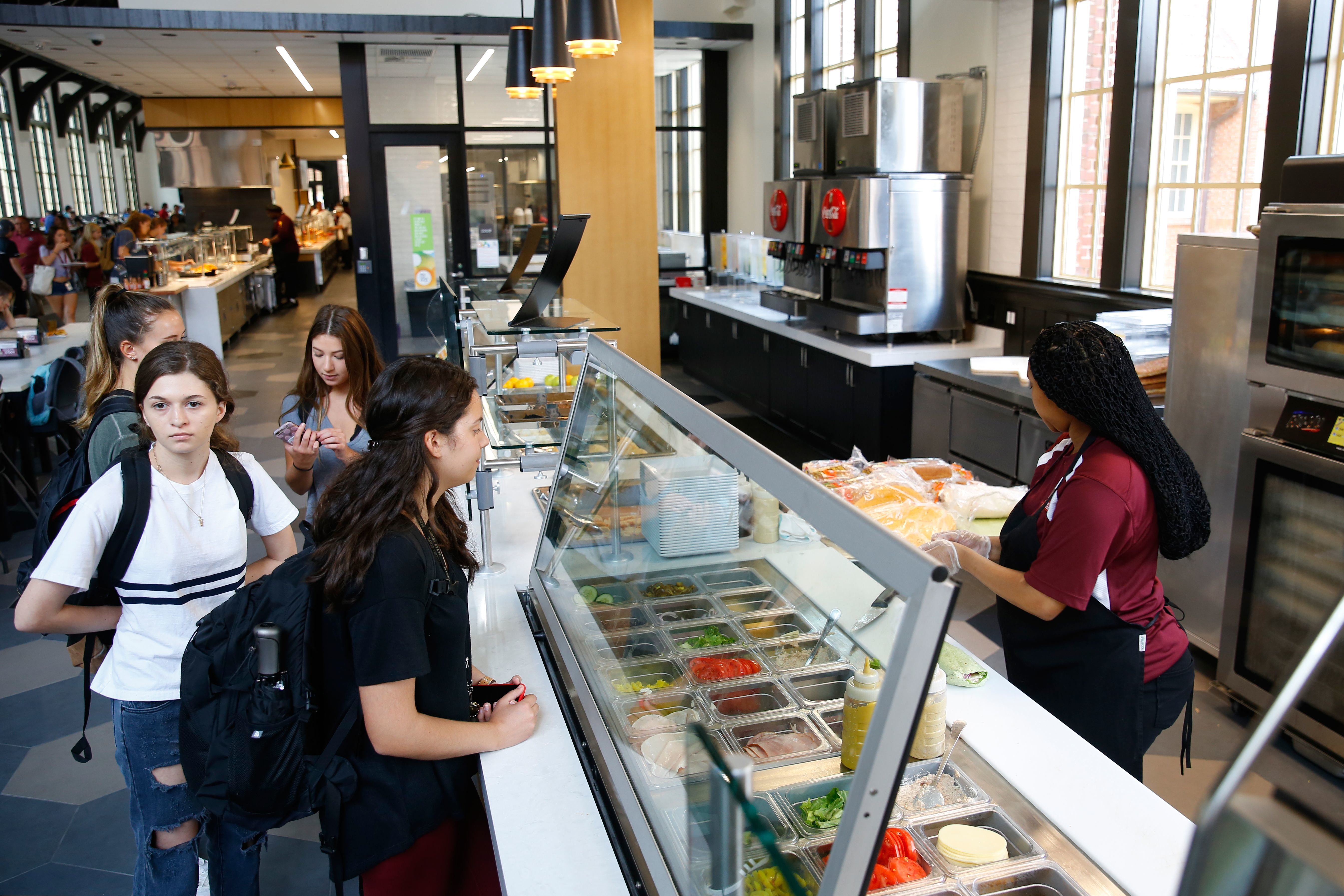 Students order from a new deli area of the Suwanee Dining Room at Florida State University. Customers are able to chose from pre-made sandwiches or can opt to build their own.