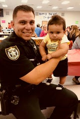 Rick and Jayden Ferrer at a Kindergarten Readiness Collaborative event.