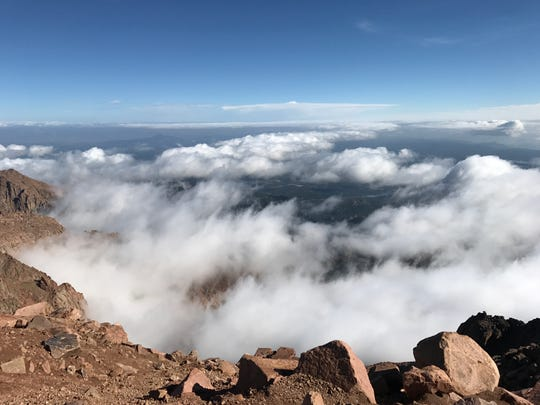 Pikes Peak in the Rocky Mountains west of Colorado Springs has a summit of 14,115 feet. It's one of the 53 mountains in Colorado with a height of at least 14,000 feet.