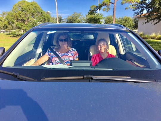 Family Meals volunteers Delores Reinke and Jan Autin  get ready to deliver meal bags to Treasure Coast families the last weekend in July.
