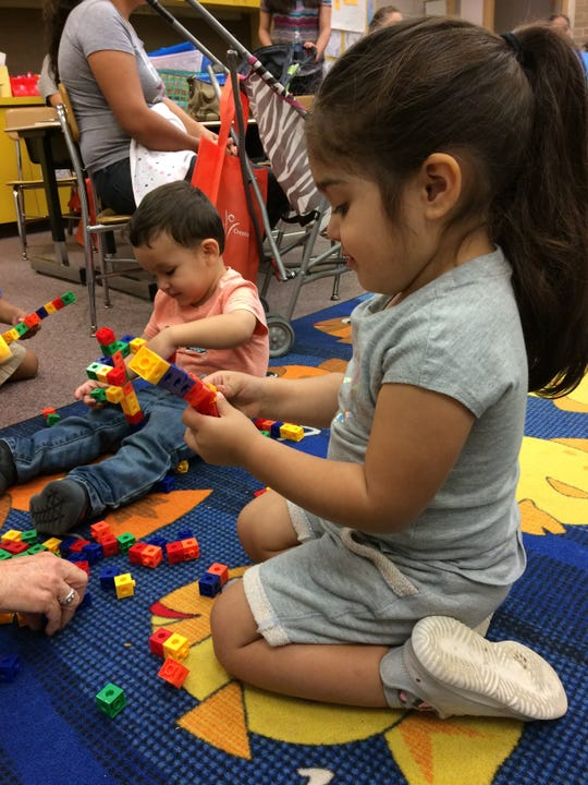 Children play with building blocks at a Kindergarten Readiness Collaborative event.