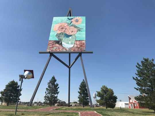 "The world's largest easel is in Goodland, Kansas, just before the Colorado border. It's 80 feet tall with a reproduction of Vincent van Gogh's ""Three Sunflowers in a Vase."""