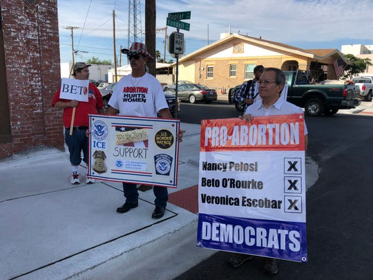 Protesters gather outside the building where House Minority Leader Nancy Pelosi was meeting Wednesday with El Paso Democratic leaders.