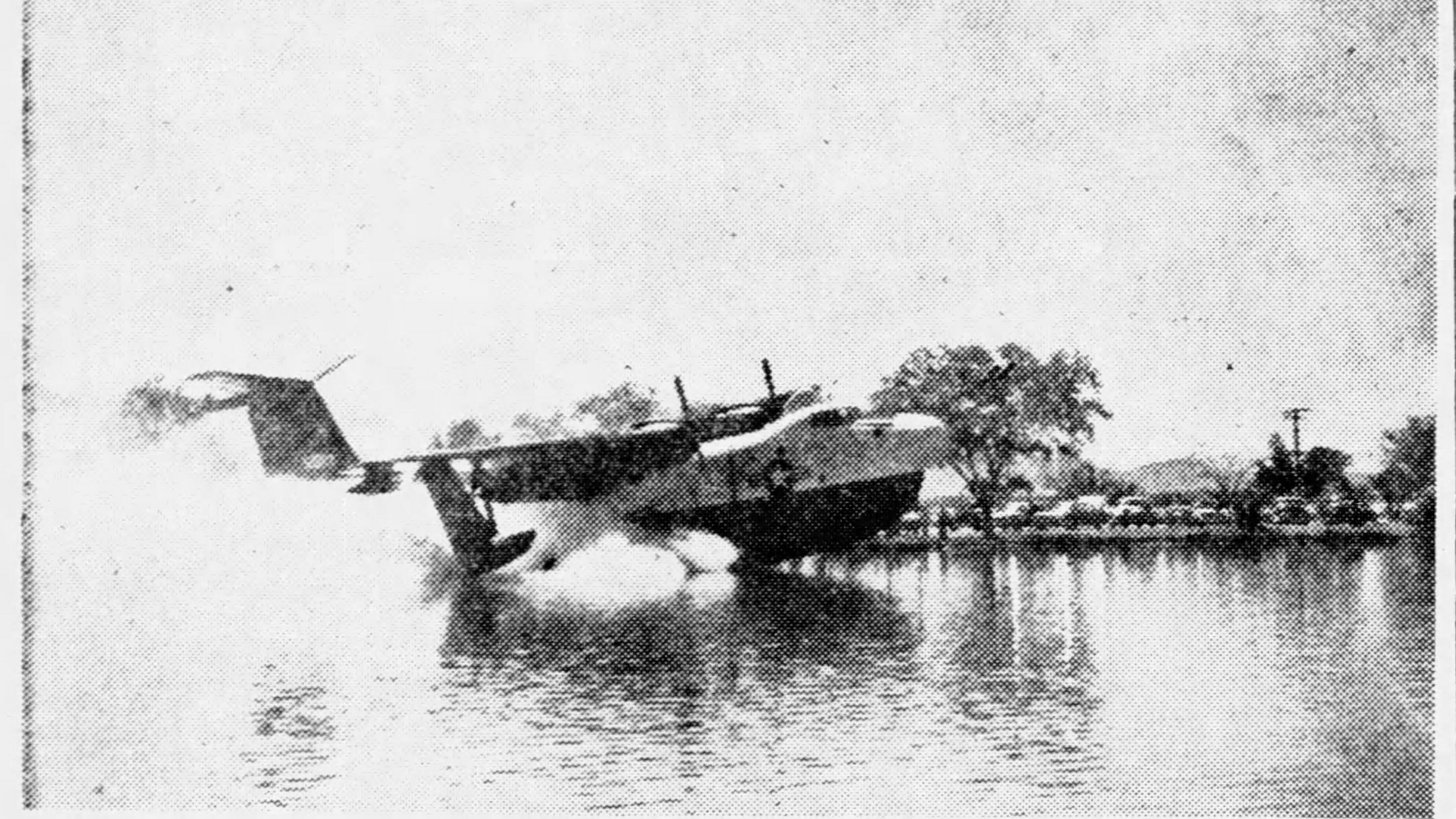A Navy seaplane is shown after it made an emergency landing in Ascarate Lake in 1960.