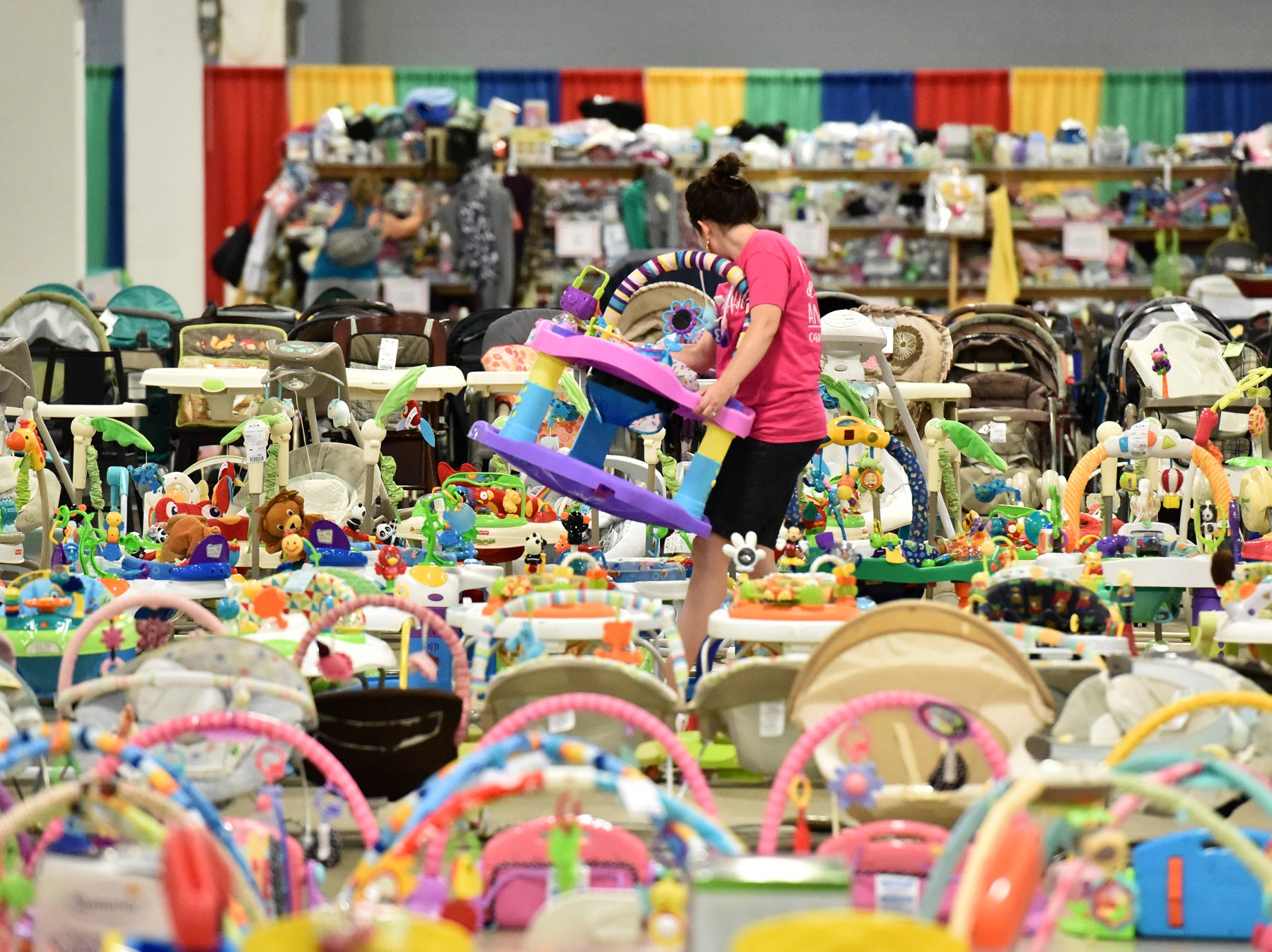 People buy and sell clothes and other items during the Switch-A-Roos children's consignment event at the TD Convention Center in Greenville on Wednesday afternoon, August 8, 2018. The event will be held through the weekend ending at 5pm Sunday evening.